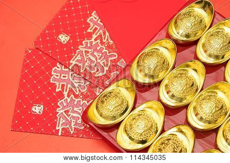 Gold Ingots On Red Envelope Of China In The Chinese New Year Festive