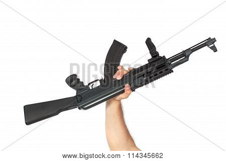 Hand Holding Machine Gun Isolated On White