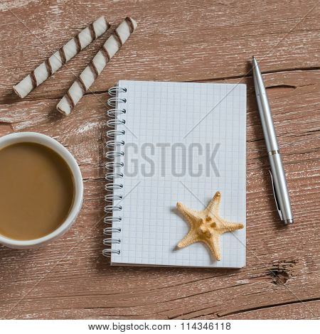 Clean Blank Notepad, Cookies, Cup Of Coffee,  Starfish. Travel And Weekends Background. Free Space F