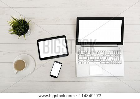 Mock Up On A Table With Laptop, Tablet, Smartphone And A Cup Of Coffee