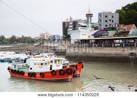 VUNG TAU, VIETNAM - December 16, 2015: Old fishing boats and waterfront in Vung Tau