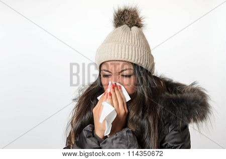 Young Woman With A Seasonal Winter Cold