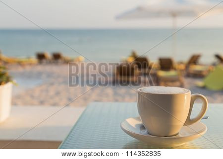 A cup of tasty coffee in a cafe on the beach. A delicious drink.