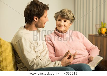 Grandson Supporting His Grandmother