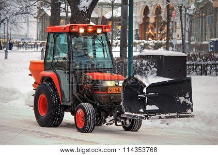 Red Snow Removal Tractor In City