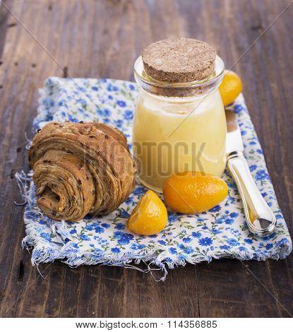 Fresh croissants for breakfast Kurd with lemon and fresh kumquats