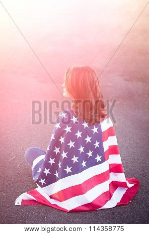 Dreaming Patriot Woman Sitting Down With American Flag Wrapped Around Her. Deployment, Military Life