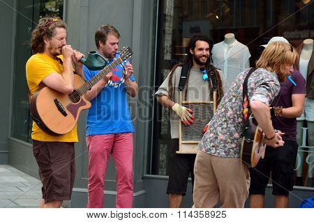 Street musicians playing odd instruments in Bath, UK