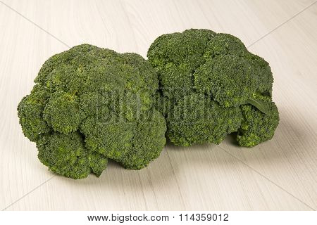 Some Green Brocolis Over A Wooden Surface.