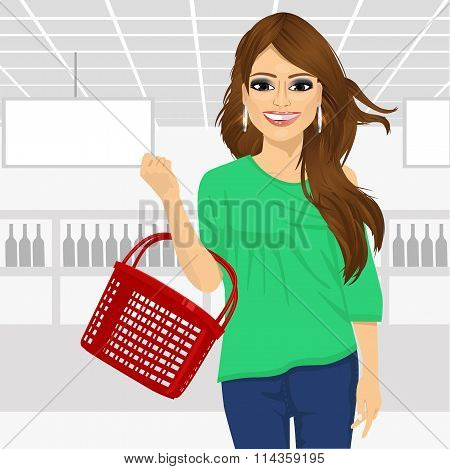 smile woman holding an empty shopping basket in supermarket