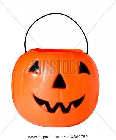 Plastic Jack o lantern isolated on white