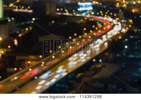 Abstract blurred bokeh lights city freeway road cured