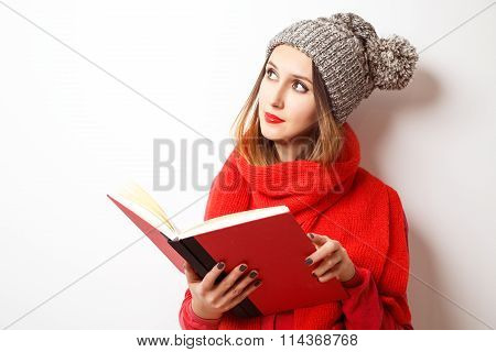 Lovely Hipster Girl in Winter Clothes with Book