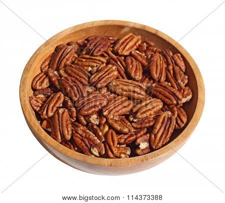 Pecan nuts in wooden bow isolated on white