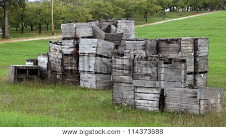 Weathered wooden grunge crates stacks on the farm land