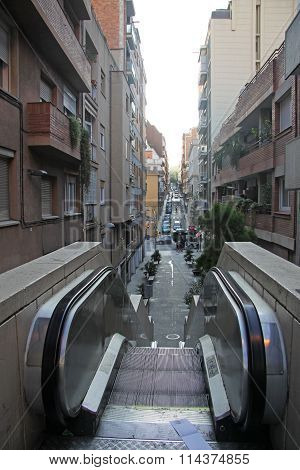 Barcelona, Catalonia, Spain - December 12, 2011: Escalator Leading To Famous Park Guell Entrance In
