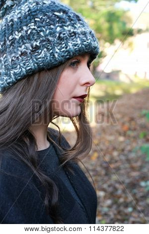 Profile Of A Beautiful Teenage Girl Wearing A Pom Pom Hat