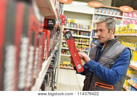 Merchandiser checking products in automobile store