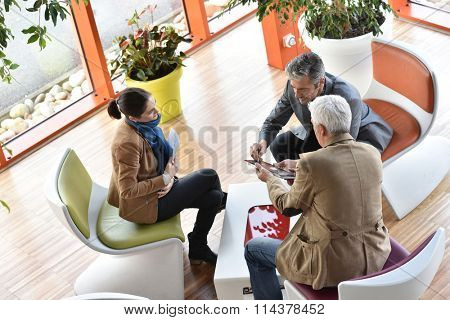 Business people gathering in meeting area