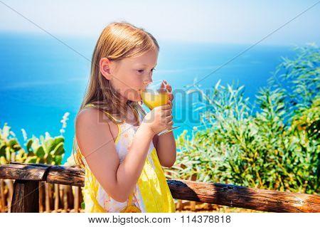 Little girl drinking traditional southern Italian lemon juice