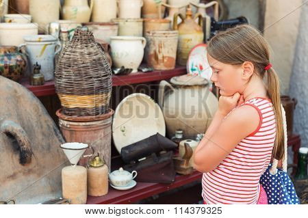 Cute little girl at flea market