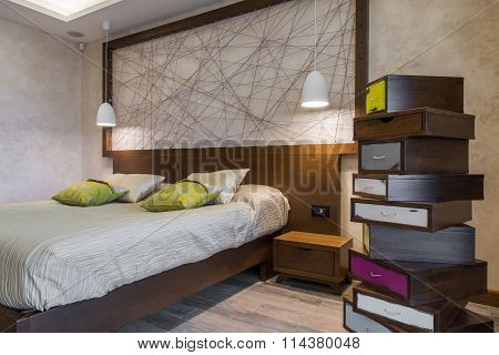 Bedroom interior with double bed and chabby chic style commode