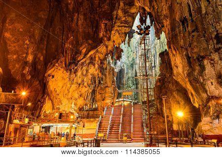 KUALA LUMPUR, MALAYSIA - SEPTEMBER 20, 2015: Worshippers pray inside Batu caves Hindu Shrine.