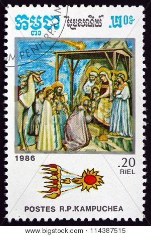 CAMBODIA - CIRCA 1986: a stamp printed in Cambodia shows Comet above Adoration of the Magi in Painting by Giotto, Halley's Comet, circa 1986