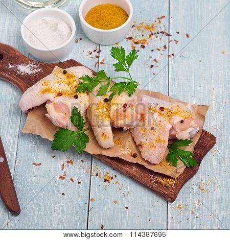 Fresh Raw Chicken Wings On Chopping Board