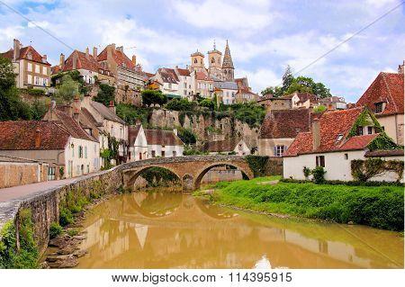 River through medieval Semur en Auxois, Burgundy, France