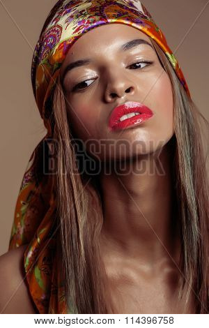 beauty young afro american woman in shawl on head smiling close up swag