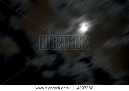 Blurred Thick Wispy Clouds Move Across The Light Of The Moon