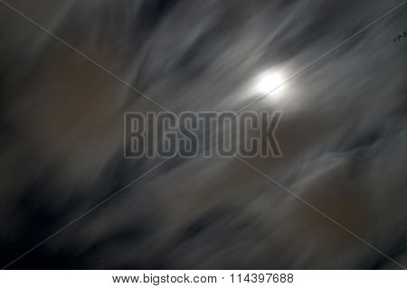 Clouds Creating Long Lines In Moonlight