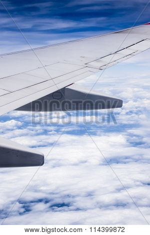 Airplane wing with clouds