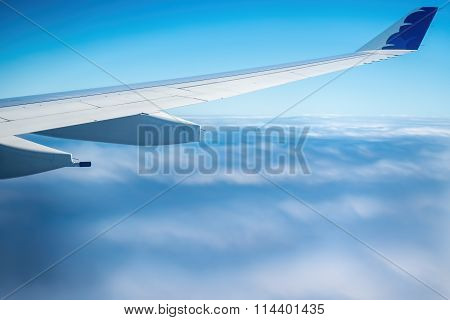 Plane flying above clouds