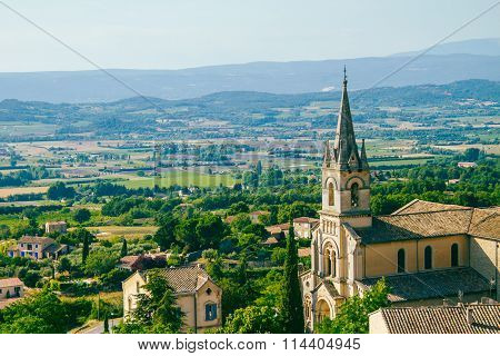 Church In Bonnieux With Lavender Fields Beyond.