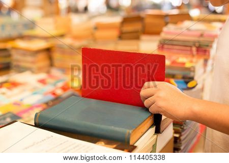 Young Boy Reading A Book In A Bookstore