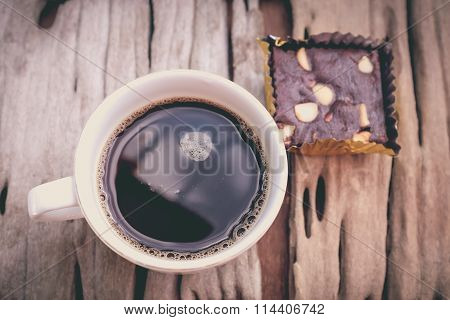 Top View. Chocolate Brownie And Hot Coffee On Wooden Background. Retro Style.