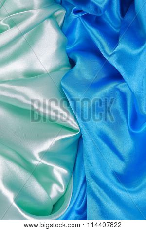 Blue And Light Green Silk Satin Cloth Of Wavy Folds Texture Background