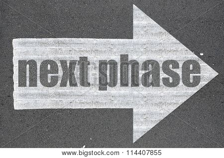 Arrow On Asphalt Road Written Word Next Phase