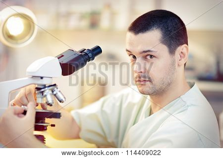Funny Young Male Scientist with Microscope