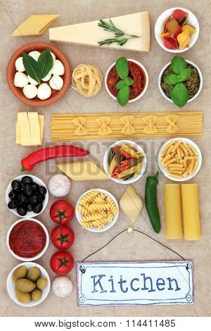 Healthy mediterranean diet and food ingredients with old kitchen sign forming an abstract background over natural hemp paper background.