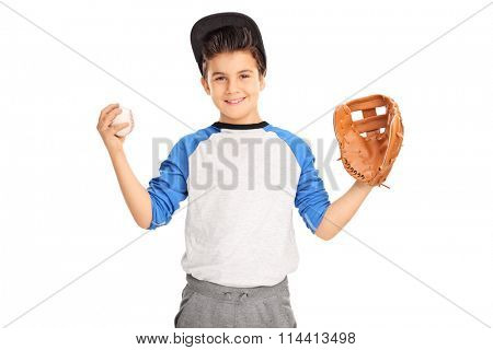 Little kid with baseball glove holding a baseball and looking at the camera isolated on white background
