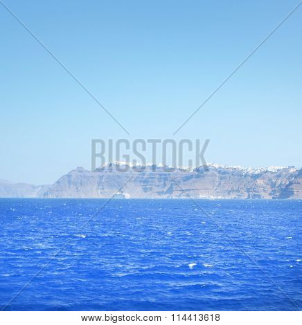 Clear azure sea in Greece and island with mountains on the background.