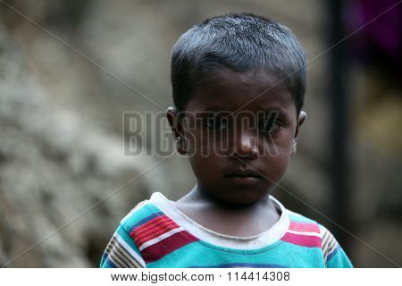 A portrait of a poor boy from India in his unfortunate condition.