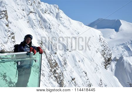 Woman Admiring The Landscape In The Alps