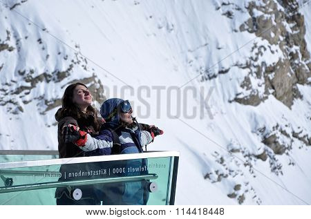 Women Admiring The Landscape In The Alps