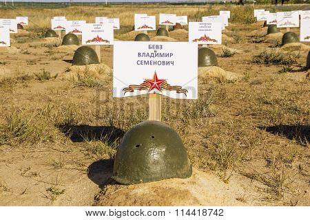 Soldier's Helmet On A Grave Of The Soviet Soldier. Volgograd, Russia