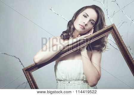 Art Noisy Image Of Woman Holding Picture Frame In Fantasy Concept