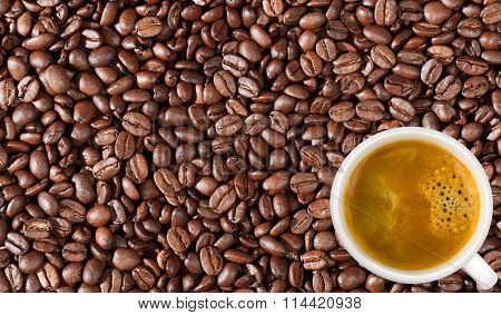 Close-up Of Coffee Beans Background And White Coffee Cup
